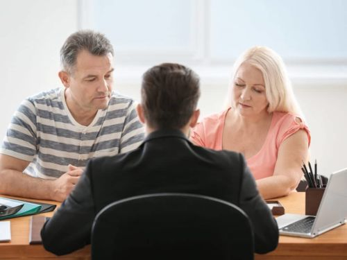 couple speaking to an attorney