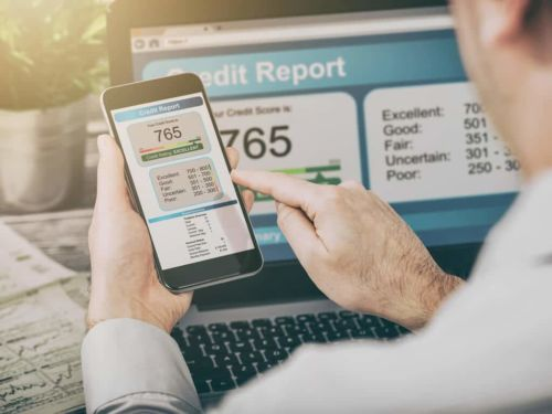 man checking credit report and credit score online